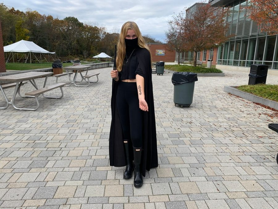 Senior Elizabeth Hiebert dresses up as the cold and cunning Lucius Malfoy. She was wearing all black with a cape and wand, accessorized with a serpent necklace and a Death Mark on her arm.