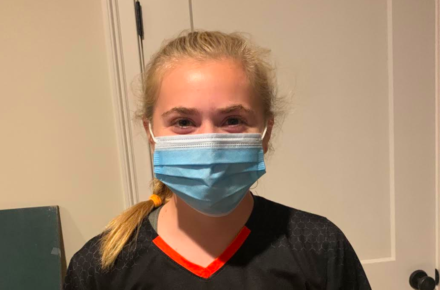 Junior Lauren Medeiros wears her mask after a soccer game. WSPN's Julia Raymond explains when and where to wear a mask.
