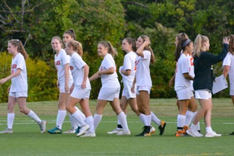 Senior Sophia Cvrk greets her teammates after a soccer game last fall. This fall, Cvrk isn't playing due to COVID-19 concerns.