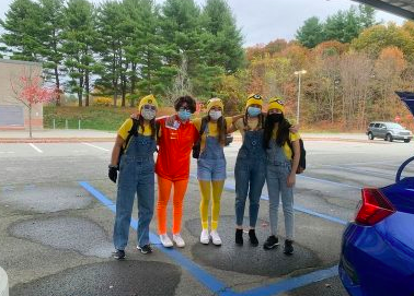 "A group of senior girls dress up as Vector and Minions from the movie ""Despicable Me."""