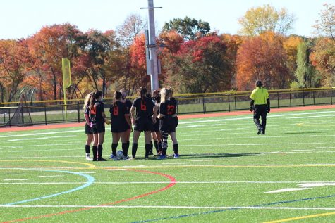 The WHS girls varsity soccer team huddles up at the start of the fourth quarter against Bedford. With strong teams like Bedford, the team has faced some tough competition throughout their season