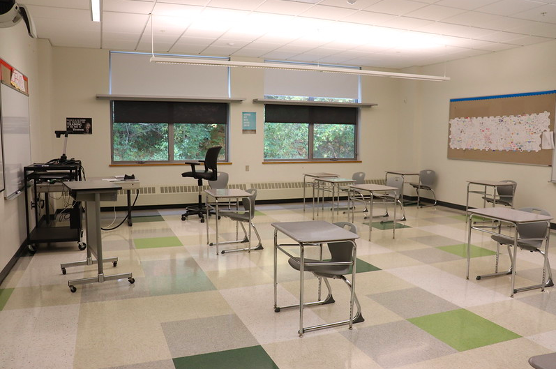 A math classroom appears full with desks spaced six feet apart.