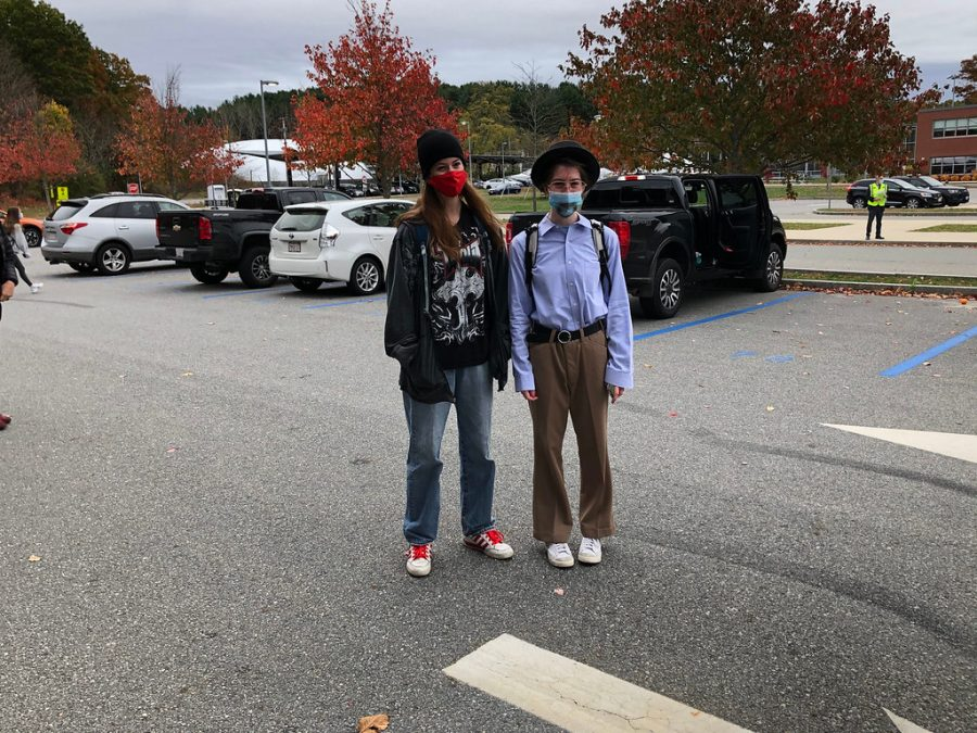Seniors Darcy Foreman and Rebecca Lieb fit their costume personas as they begrudgingly get a picture taken of them. Lieb is dressed as Walter White and Foreman as Jesse Pinkman, together being the crime duo in