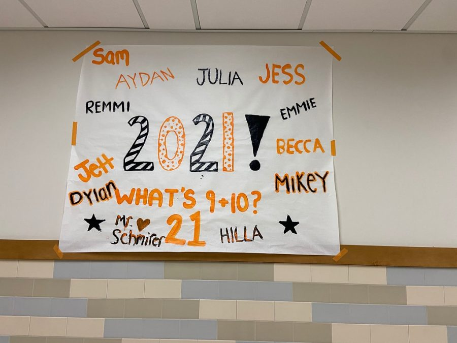 This finished senior poster is showcased in front of the English hallway.