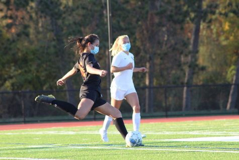 Sophomore center defender Samantha Tyska clears the ball down the field to get it out of Wayland