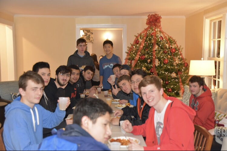 The 2019-2020 boys swim team poses for a photo at one of their weekly team dinners. Each year, sports teams at Wayland High School gather to celebrate the holiday season.