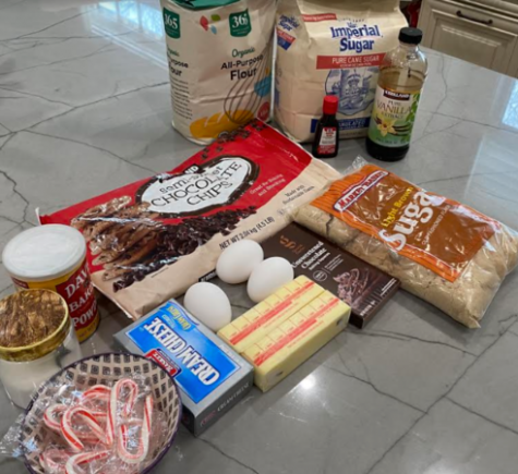 Gather all your ingredients: unsalted butter, chocolate chips, baking chocolate, all-purpose flour, baking powder, salt, eggs, egg yolk, light brown sugar, granulated sugar, vanilla extract, cream cheese, powdered sugar, peppermint extract and crushed candy canes.