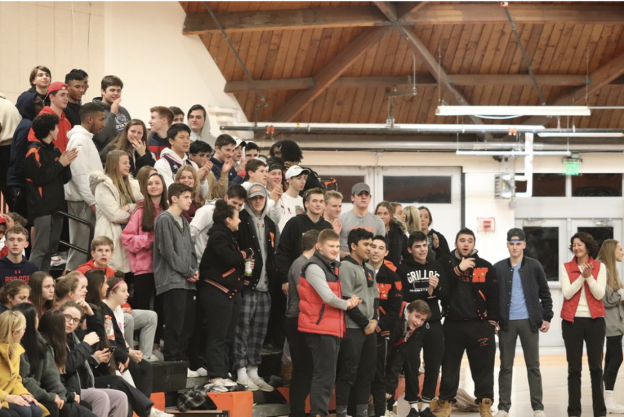 Wayland students cheer on the boys varsity basketball team during its game against Weston last season. As of now, students will not be allowed to watch winter sporting events this year.