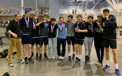 Junior Jake Moser is pictured with his SMASH Volleyball club team at one of their tournaments. He started playing volleyball freshman year and immediately knew he enjoyed all aspects of the sport.