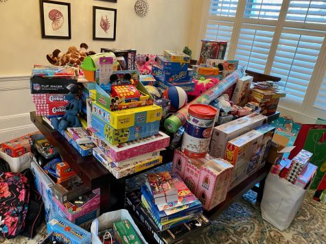"During the holidays, many WHS students look to give back to their community. Two WHS students, sophomore Bella Boyajian and junior Lily Boyajian created a toy drive for kids in foster care. ""Our goal was to fill at least five bags of toys."" Bella said. ""With all of the generous donations we are now filling more than ten bags and hopefully more to come."""