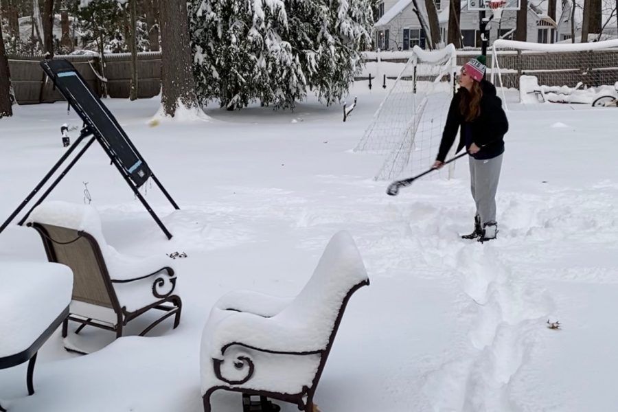 Junior Sammy Johnson enjoys the snow while playing wall ball. She decided to do something physical between two of her classes because it was hard for her to sit on zoom indoors while she watched snow falling outside on a snowy December day.