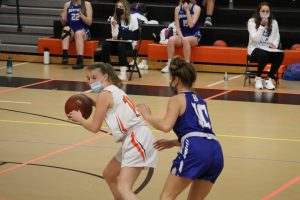 Senior captain Abby Gavron protects the ball from a Bedford defender and quickly passes the ball, so she isn't called for a double dribble. Gavron utilized her speed whenever she had to bring the ball up the court to create opportunities for her team.