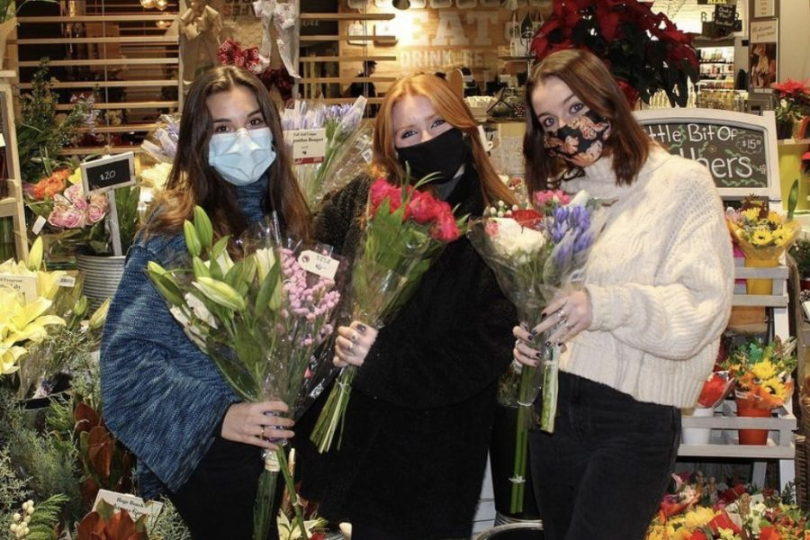 """Yearning for a taste of what real entrepreneurs experience, Wayland High School seniors Cassie McGonagle, Kathleen Tobin and Mia Mazokopos ventured out and started their very own flower farming business. """"We thought it would be a good opportunity to really dive into this business and learn from good hands on experience,"""" Tobin said."""