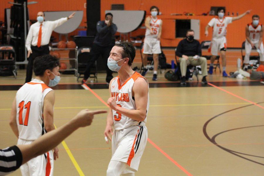 Boys varsity basketball starts the season with a win