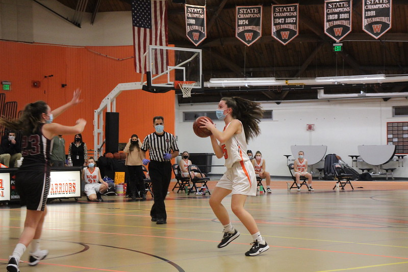 Junior Haley Melvin prepares to take a three-point shot. During the game, Melvin led the team by scoring 13 points.