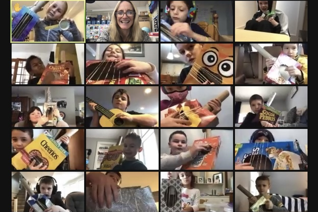 Miriam Morrison's first grade students at Happy Hollow Elementary play with homemade instruments during a remote lesson. WSPN's Genevieve Morrison discusses the benefits of sending students like these back to school four days a week.