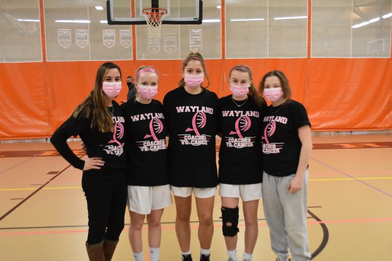 Head coach Amanda Rukstalis poses with seniors Meredith Prince, Ella L'Esperance, Abby Gavron and manager Maddie Yaffe in celebration of Senior Night. Unlike the typical senior night, parents were unable to attend the occasion due to COVID-19 regulations. Players and families missed out on the usual rose exchange and celebration at the end of the game.