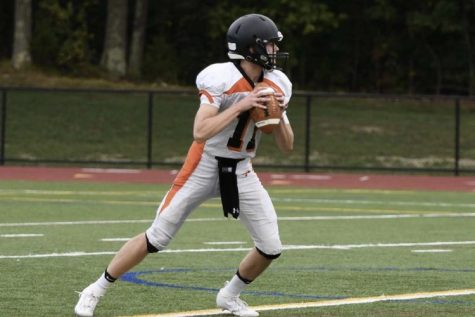 """Senior Luke Tacelli prepares for the upcoming season. The football season was pushed back due to COVID-19.  """"I am really excited for this upcoming football season because I have worked really hard for it and been waiting for a long time,"""" Tacelli said."""