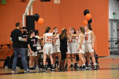 Girls varsity basketball head coach Amanda Rukstalis prepares to end a huddle before the Warrior
