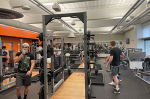 The WHS football team prepares for their upcoming Feb. 22 season start by hitting the fitness room. This year, all Fall II sports will have no postseason due to a recent MIAA decision.