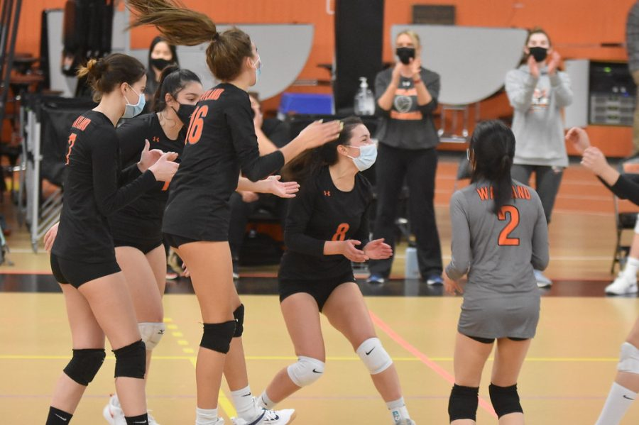 After winning the serve, the players jump together to celebrate Wayland's point gain.