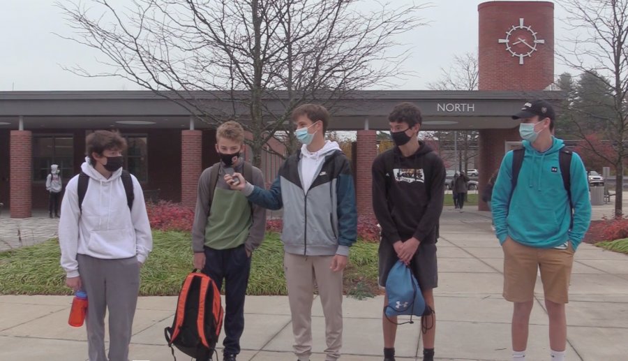A group of WHS freshmen stand in their new school's courtyard while a WSPN reporter interviews them. Adjusting to a different learning environment is hard enough, but with the pandemic's challenges and unpredictabilities, the freshmen had to stay motivated through all the changes.