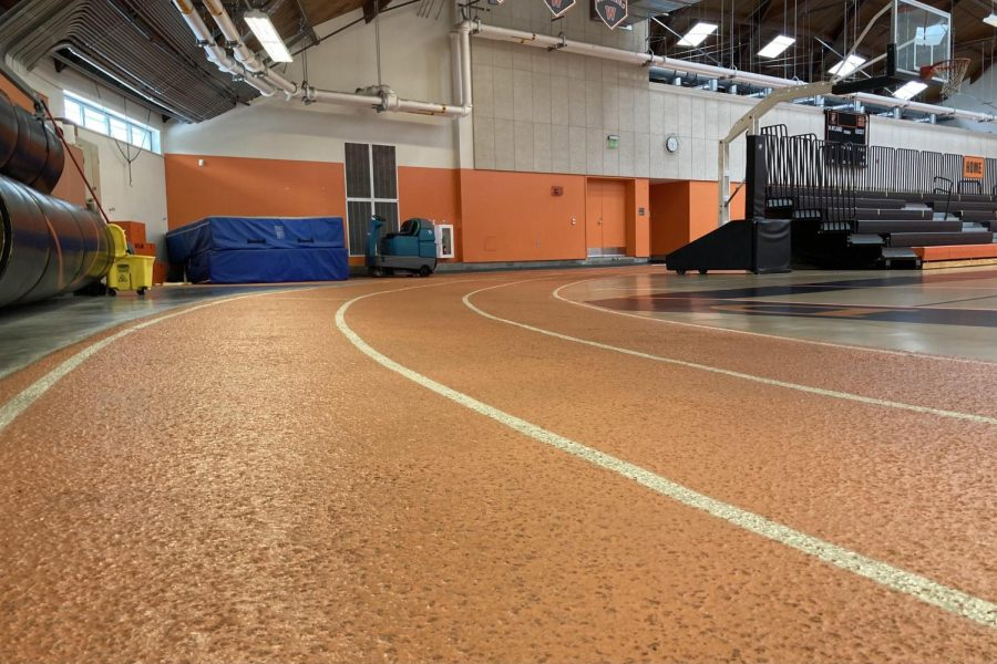 """The WHS field house is typically a space in which runners practice and compete during the winter months. The MIAA opted to move this year's winter track season outside as a result of the COVID-19 pandemic, but athletes are optimistic regardless. """"I hope with this extra time I can get some more quality training in,"""" senior indoor track runner Zachary Campana said. """"I think that it makes me more excited to compete in the upcoming spring track season with a brand new track to run on, [and I will have] a lot of time to perfect my form and abilities in the 110m hurdles, my event."""""""