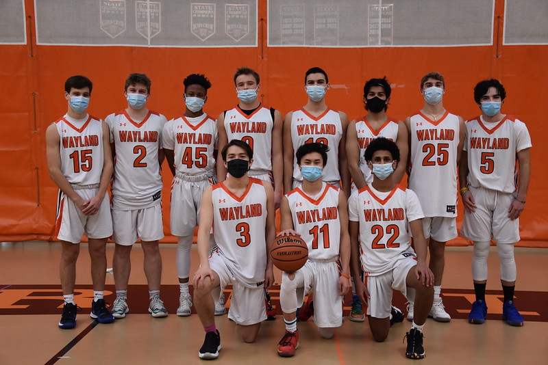 On senior day, the first game of the DCL playoffs, the boys varsity basketball team takes one last team photo together. Unfortunately, the Warriors lost in a close game, with a final score of 51-52.