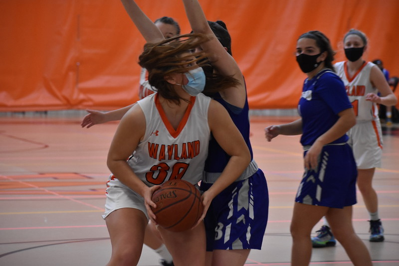 Junior captain Sammy Johnson looks at the basket in hopes of driving the ball into the middle of the paint.