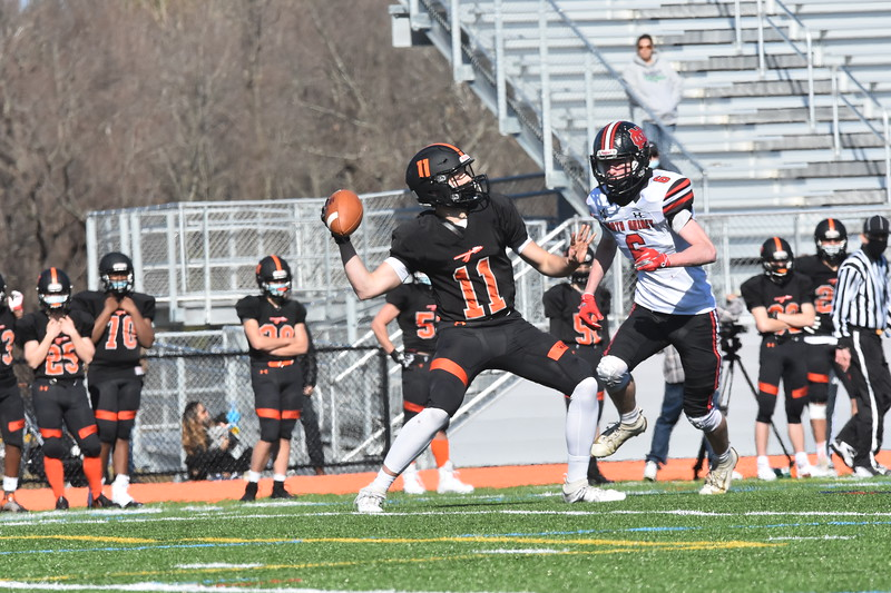 North Quincy breaks through Wayland's defense, while senior quarterback Luke Tacelli gets rid of the ball. His teammates ran the play up the field, but Tacelli made a rushed pass due to a break in the offensive line.