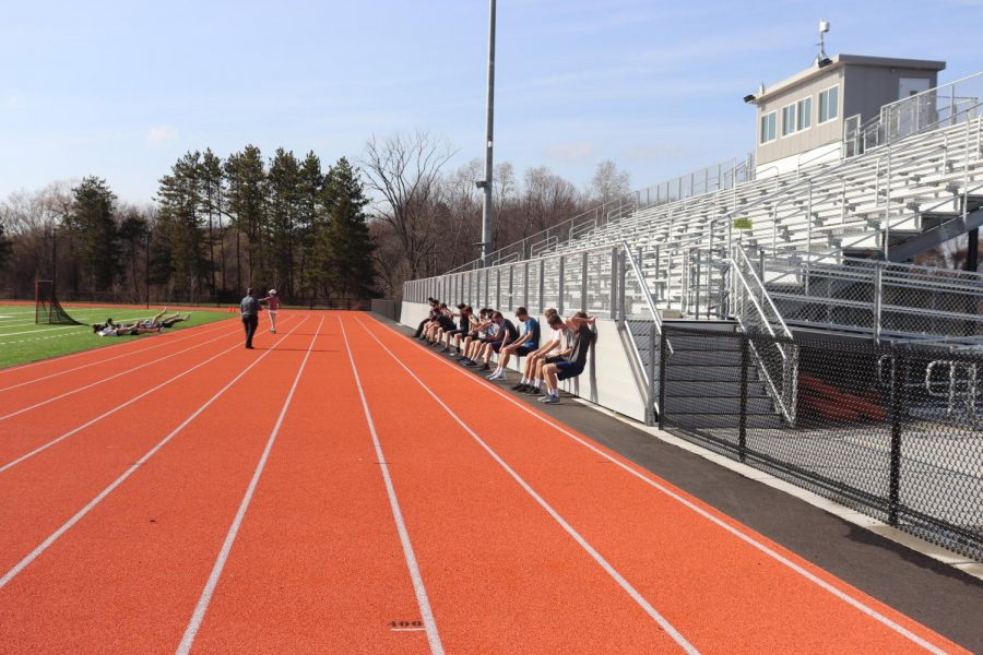 WHS track athletes exercise in front of the newly renovated home stands. The bleachers, which have served as a vantage point for family members to watch athletes compete, have also housed unauthorized spectators.