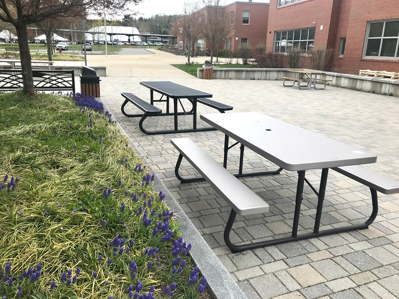 Tables are placed in the courtyard so students can spread out during their free time. Administrators encouraged students to utilize this space for social distancing, especially with the return of the majority of the student body.