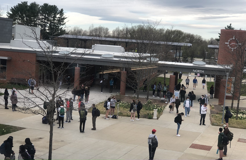 Students and staff congregate outside before the start to the school day. Many got to school as early as 7:50 to try and avoid traffic.