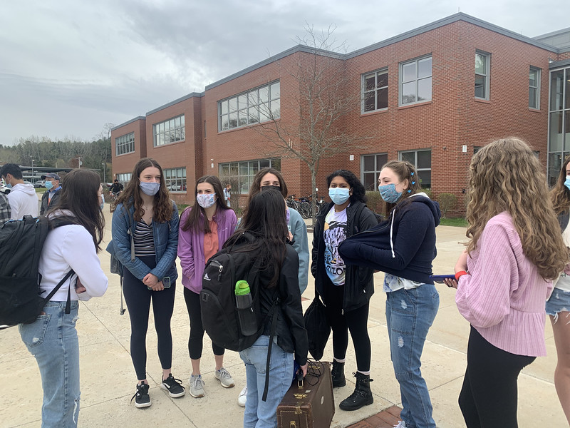 A group of sophomore girls gathers together outside, awaiting the start of school. Both cohorts combined for the first time since last March when COVID-19 began. Students are very excited to be back together again.