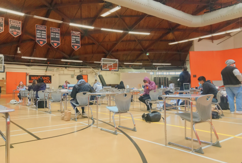 Students remain socially distant during lunch per health guidelines. This comes as students and faculty await the April 27 full-in model. With this decision comes the loss of Wednesdays and a third lunch added to the schedule.