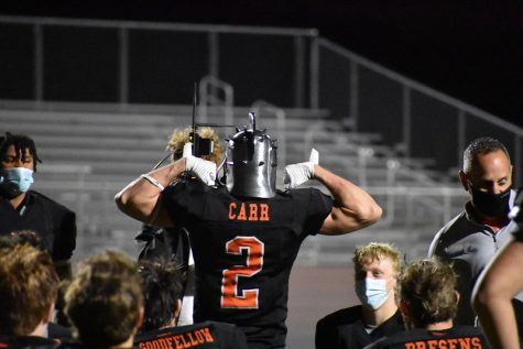 "Senior Will Carr celebrates for his winning of the warrior helmet for that game. By showing all his effort and scoring two touchdowns while continuing to play strong defense, Carr earned this honor of receiving the helmet. ""It felt great to win the helmet, especially after a tough week last week,"" Carr said."