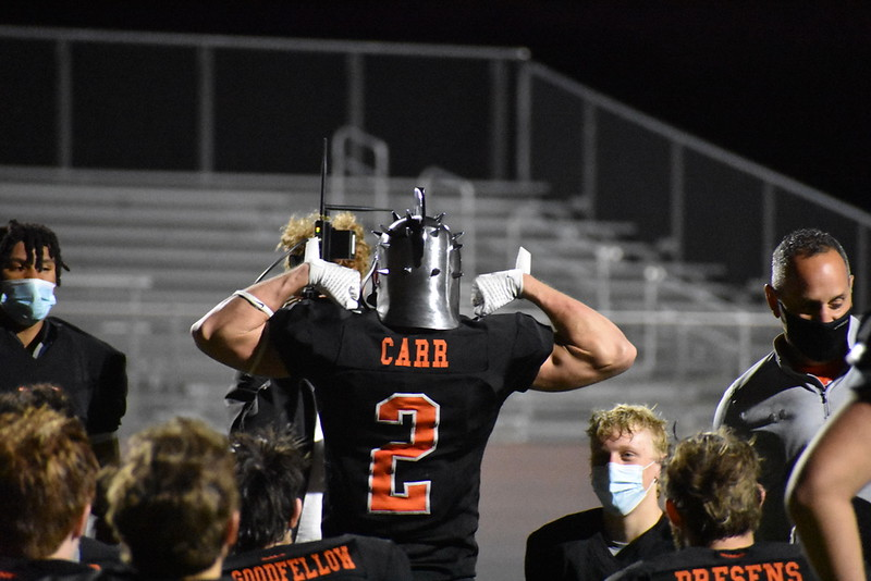 Senior Will Carr celebrates for his winning of the warrior helmet for that game. By showing all his effort and scoring two touchdowns while continuing to play strong defense, Carr earned this honor of receiving the helmet.