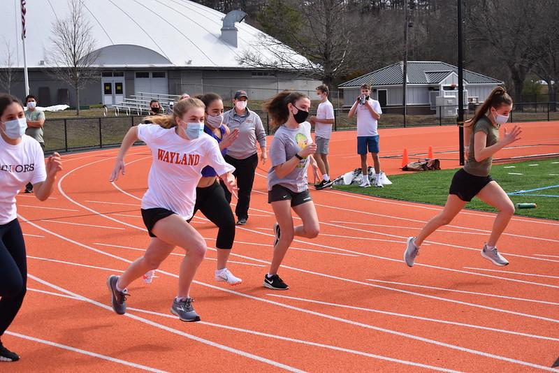 Senior Jenna Brandaleone, junior Lauren Medeiros, sophomore Renata Maza and freshmen Josee Sherman and Julia DeGrenier sprint the 55-meter dash. Medeiros came out with the fastest time for the girls 55-meter.