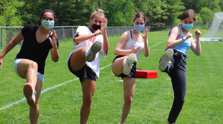 During the RAD program in a junior year wellness class, a group of junior girls practice their kicks. In the class they learned three types of kicks: sweep, straight leg and snap.