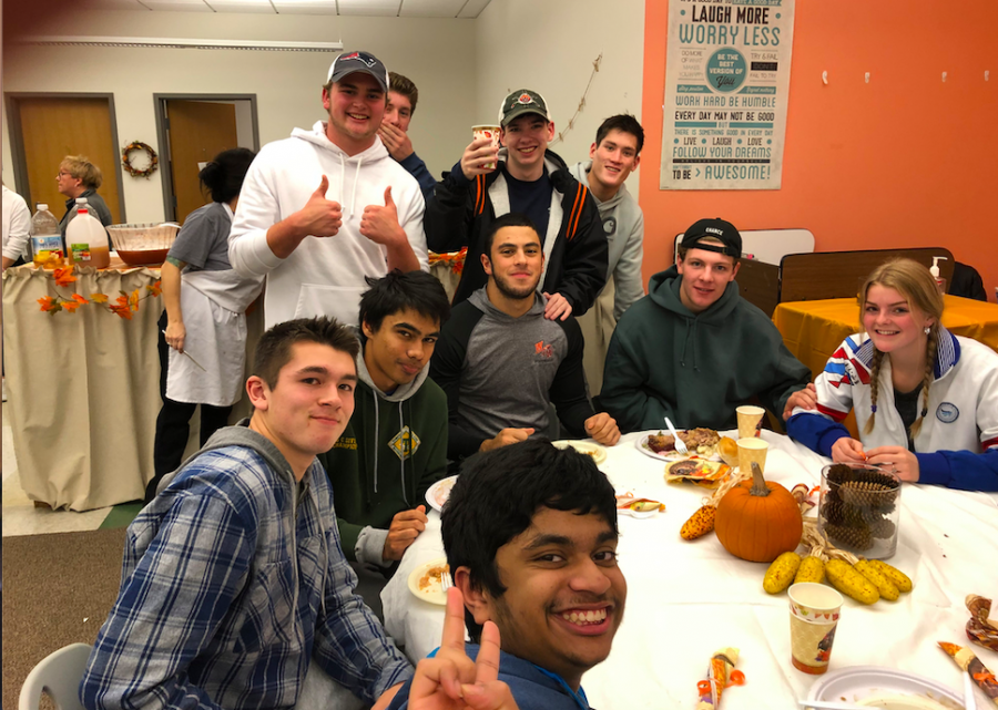 """The 2019 Lunch Bunch club members join in room B127 for a Thanksgiving dinner. """"My favorite experience has been forming relationships with people—which doesn't just happen in one single moment, junior Jonny Goldin said. It takes time to form any kind of connection with anybody, and all that time I've spent forming these relationships is my personal favorite experience at the club."""""""