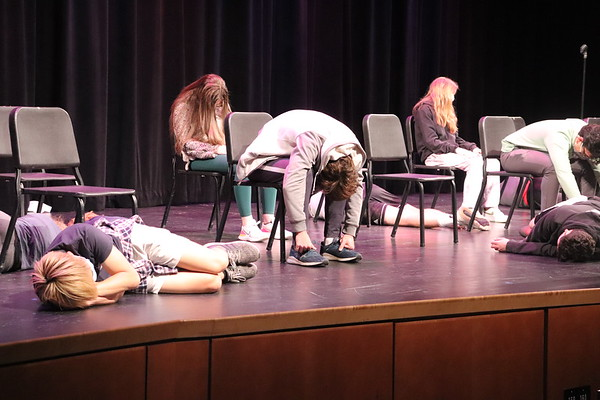 """Many of the student volunteers get comfortable after hypnotist Peter Gross tells them to """"three, two, one, sleep."""" During this period of unconsciousness, Gross gave the volunteers commands or messed with them."""