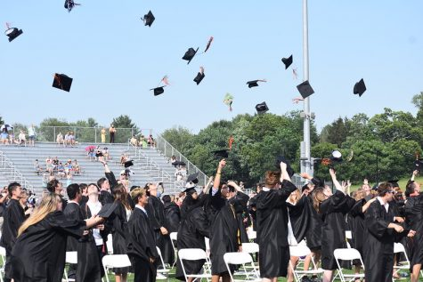 After the ceremony concludes, the Class of 2021 throws their caps in the air in celebration of graduating from Wayland High School.