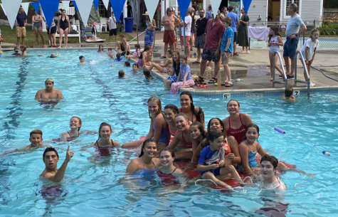 """Wayland Swim and Tennis club lifeguards gather in the pool. Many WHS students started working this summer at many different places, including WSTC. """"Working [at WSTC] just seemed fun and like a good job opportunity,"""" sophomore Sophie Roman said."""