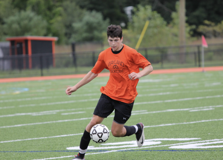 Junior Charlie Johnson attempts to control the ball and dribble it up field in Waylands preseason game again Pantucket. Johnson showed out in this preseason finale, even putting one in the back of the net. Im really looking forward to this season, Johnson said.