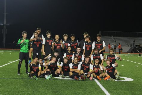 Players get together and pose for their victory picture. The game finished 2-1 Wayland, with goals scored by senior Alfonso Alvarez and junior Luke Caples.