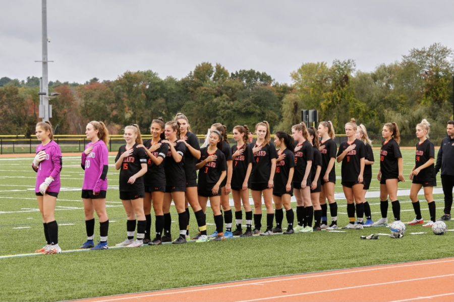 Wayland girls varsity soccer faces the flag ahead of their senior night game against Waltham. They would win 2-0, a welcome victory after losing three games in a row, which included their game against Lincoln-Sudbury.