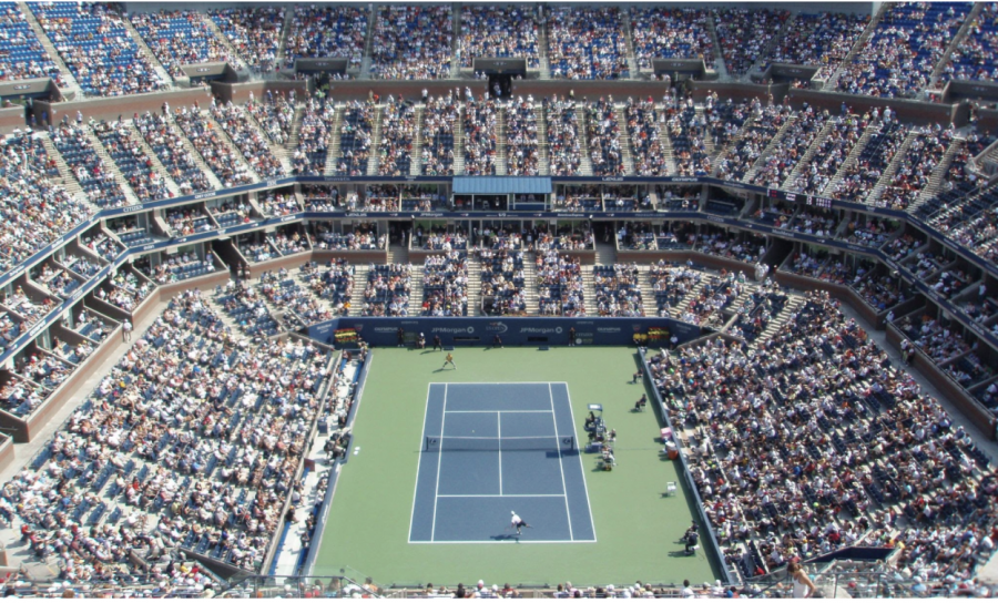 A packed house at Arthur Ashe Stadium watches mens singles during the US Open. At the 2021 US Open, fans were required to be vaccinated while players were not, sparking criticism from some fans and players.