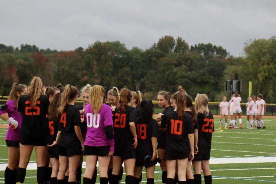 Wayland Girls Varsity Soccer has a pep talk before the start of senior night against Waltham.
